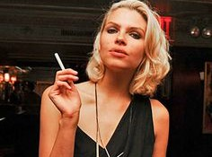a women is smoking an eciggy