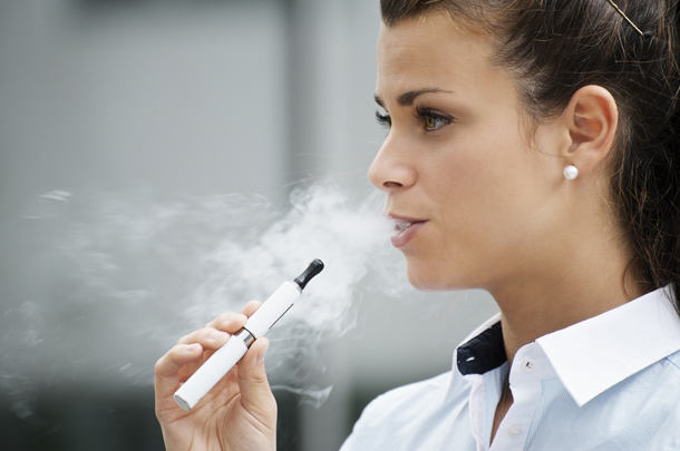 a women smoking e-cigs
