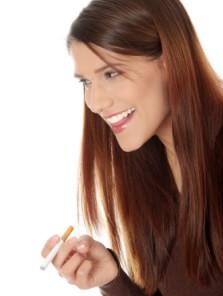 a women smoking an e cigarette