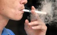 a men smoking an e-cig