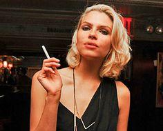 a women is smoking an eciggy